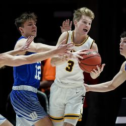 Davis' Jake Sampson comes under pressure from Fremont's Dallin Hall, Mitch Stratford and Baylor Harrop in the 6A boys basketball championship game at the Huntsman Center in Salt Lake City on Saturday, Feb. 29, 2020.