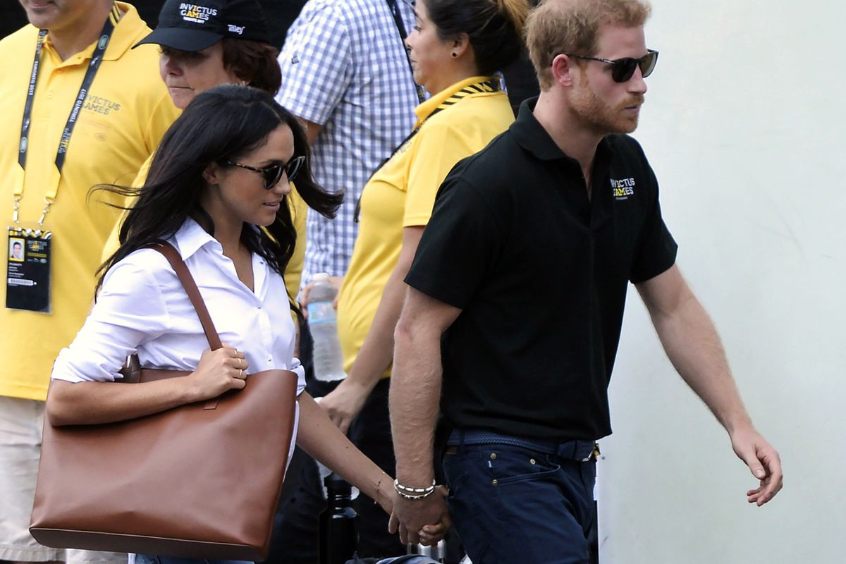 FILE - In this Monday, Sept. 25, 2017 file photo, Prince Harry and his girlfriend Meghan Markle arrive for the wheelchair tennis competition during the Invictus Games in Toronto. Palace officials announced Monday Nov. 27, 2017, Prince Harry and Meghan Mar