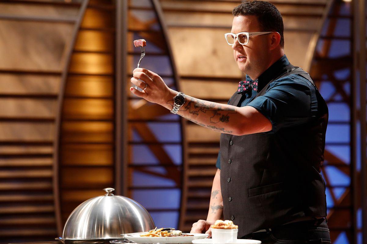 Graham Elliot examines a dish on the show MasterChef