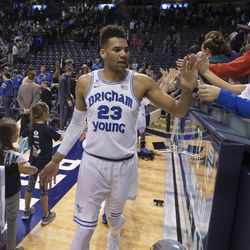 Brigham Young Cougars forward Yoeli Childs (23) greets fans following BYU's 75-73 overtime win against the San Francisco Dons at the Marriott Center in Provo on Saturday, Feb. 10, 2018.