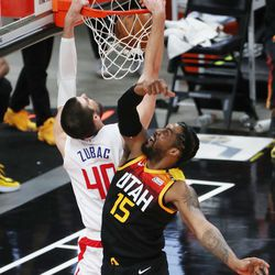 Utah Jazz center Derrick Favors (15) defends LA Clippers center Ivica Zubac (40) during the NBA playoffs in Salt Lake City on Thursday, June 10, 2021. The Jazz won 117-111.