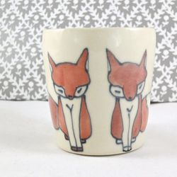 """<strong>Abby Berkson Ceramics</strong> Fox Cup, <a href=""""http://www.etsy.com/listing/117765088/fox-cup-handmade-ceramic-cup"""">$25</a>"""