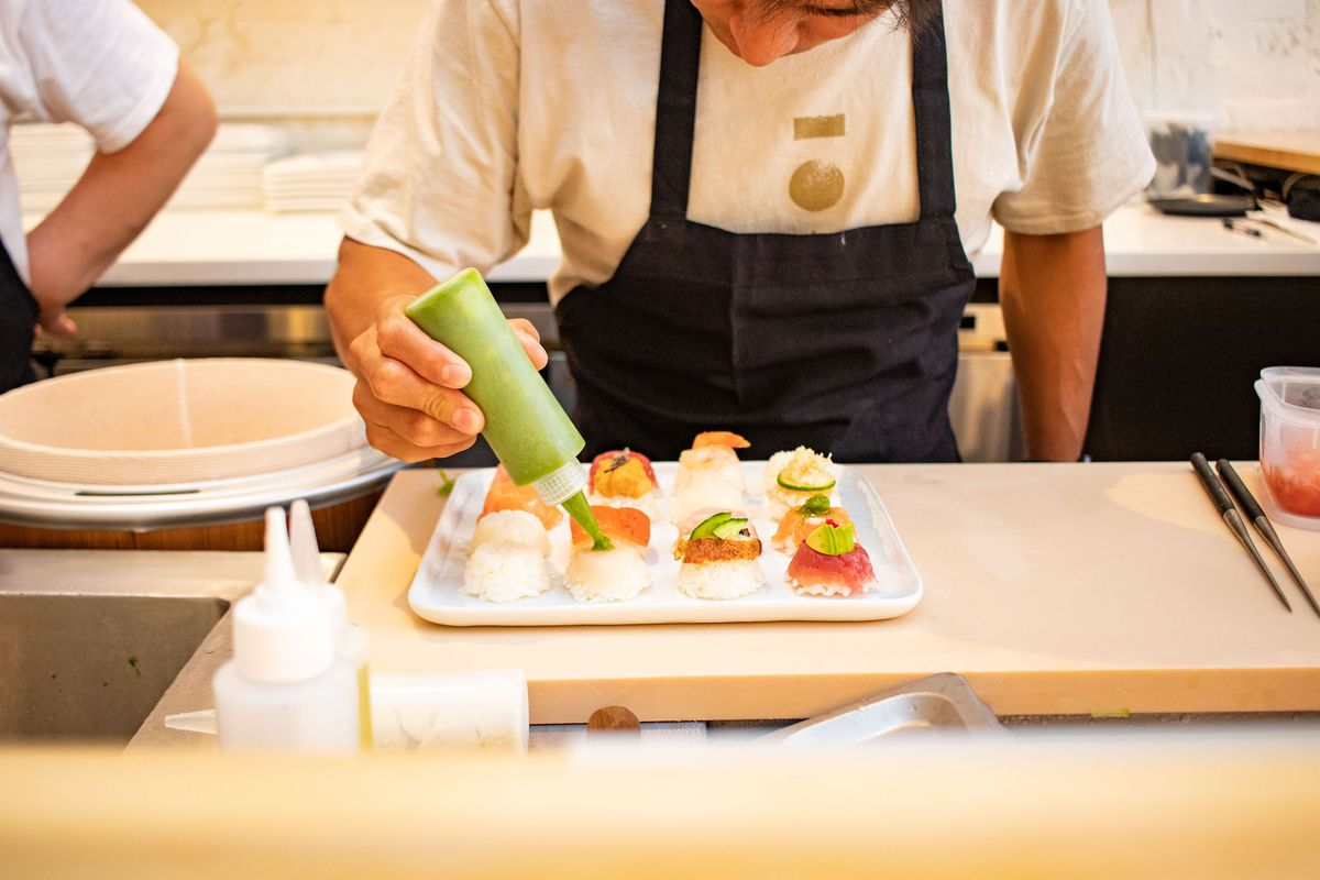 nigiri sushi bomb being prepared