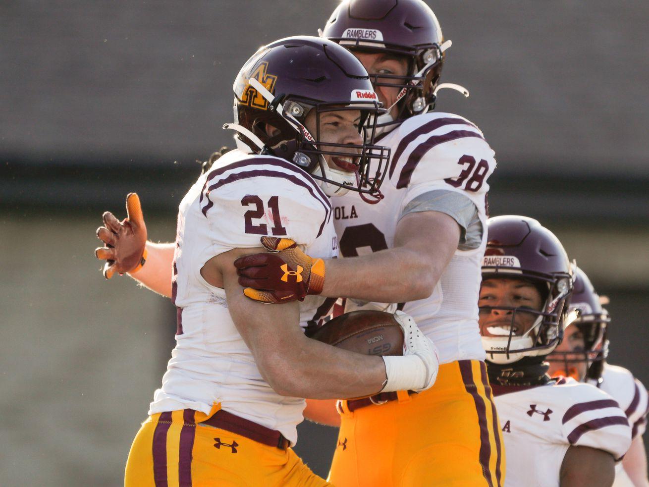 Loyola's Vaughn Pemberton (21) celebrates his touchdown against Brother Rice.
