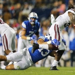 Brigham Young Cougars linebacker Francis Bernard (13) brings down Mississippi State Bulldogs running back Ashton Shumpert (32) as BYU and Mississippi State play in Provo at LaVell Edwards Stadium on Friday, Oct. 14, 2016.