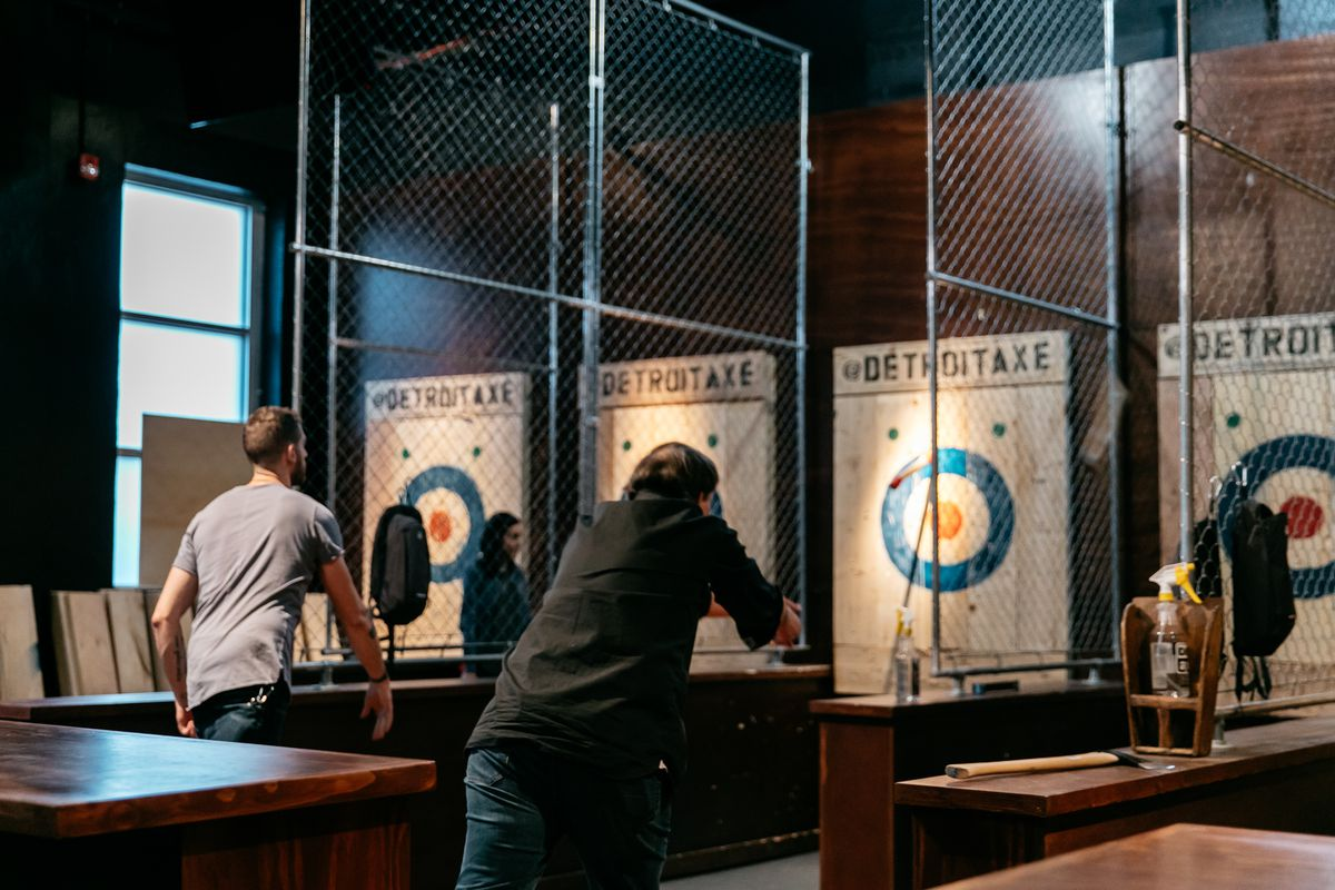 Patrons throw axes at targets at Detroit Axe in Ferndale.