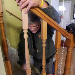 Neighbor Rick Luczak builds some handrails prior to Clara Lewis' return home from the hospital in Centerville  Thursday, Dec. 29, 2011. Clara Lewis was severely injured in mid-November when her vehicle was struck by a FrontRunner train in Kaysville at a crossing.