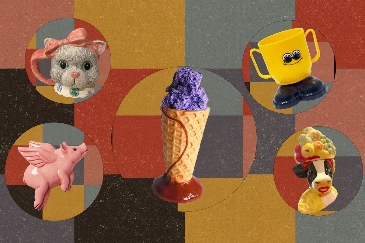 A cat mug, mug with googly eyes and shoes, a pink flying ceramic pig, a ceramic ice cream cone, and a ceramic cow wearing a fruit hat