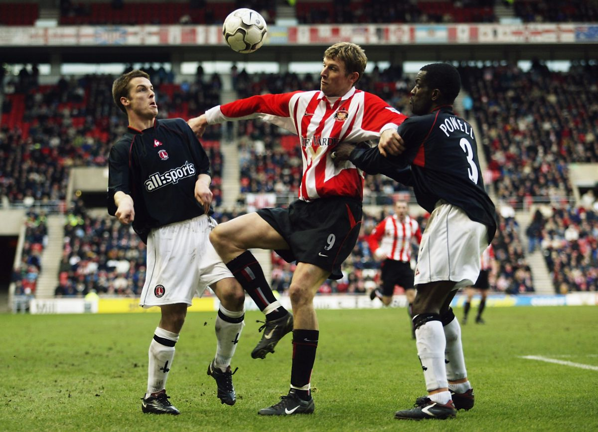 Tore Andre Flo of Sunderland and Scott Parker and Chris Powell of Charlton Athletic