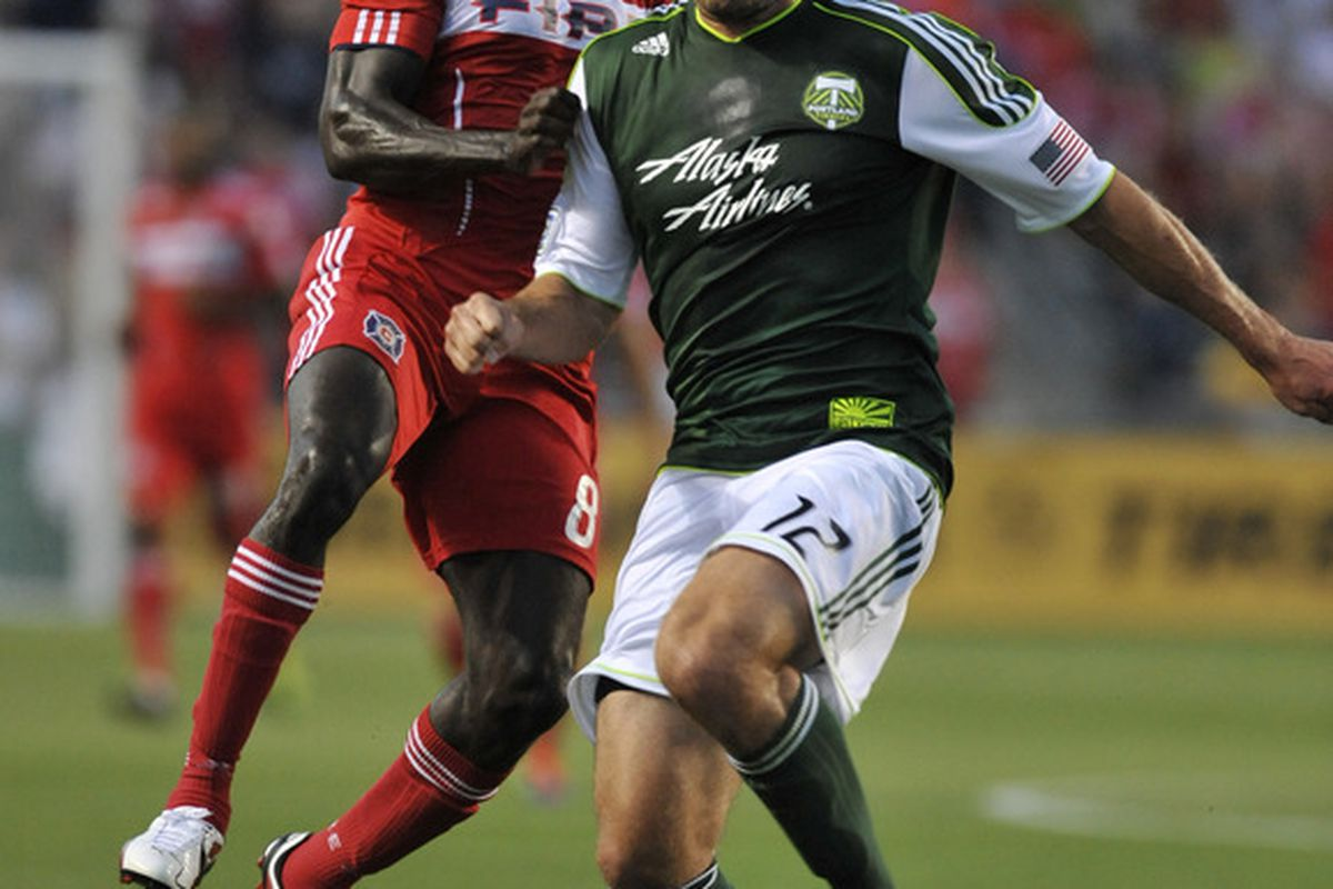 BRIDGEVIEW, IL - JULY 16: Dominic Oduro #8 of the Chicago Fire is defended by David Horst #12 of the Portland Timbers during an MLS match on July 16, 2011 at Toyota Park in Bridgeview, Illinois. (Photo by David Banks/Getty Images)