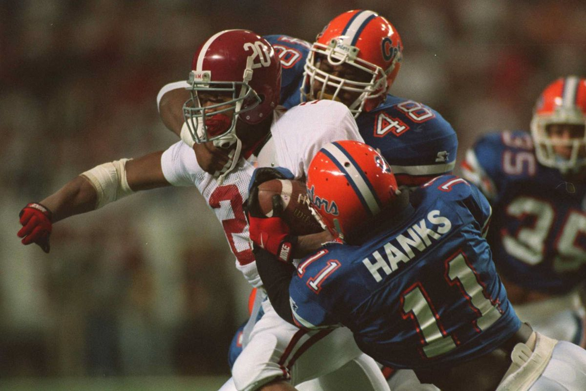Alabama's Sherman Williams being tackled by Florida in the 1994 SEC Championship.