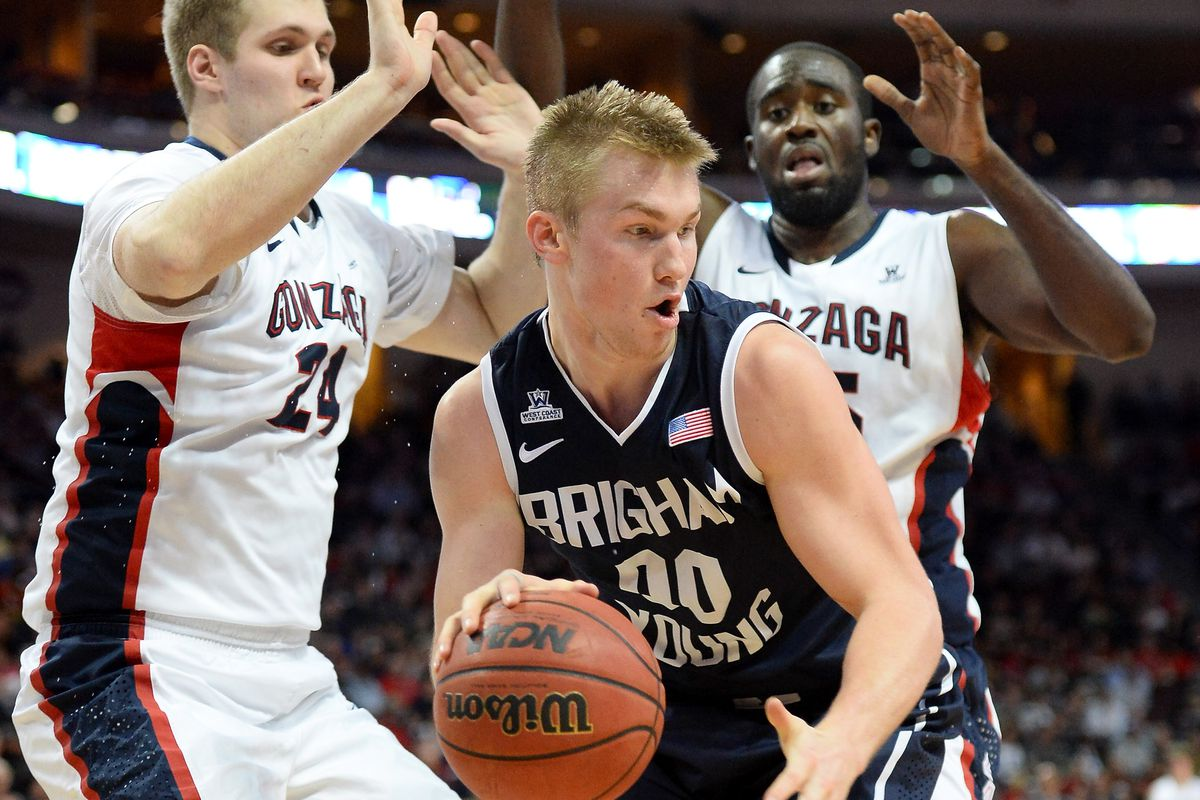 Eric Mika is double teamed by Gonzaga's Przemek Karnowski (L) and Sam Dower (R) during the 2014 WCC Tournament Championship Game.