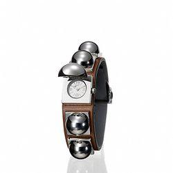 "Reed Krakoff stud watch, $1,295 at <a href=""http://www.reedkrakoff.com/online/handbags/USIndexView?storeId=16001&catalogId=16500&langId=-1#view=product-detail&styleNumber=w2006&colorCode=sad"">Reed Krakoff</a>."