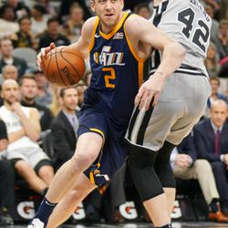 Utah Jazz' Joe Ingles (2) drives against San Antonio Spurs' Davis Bertans during the first half of an NBA basketball game, Saturday, Feb. 3, 2018, in San Antonio. (AP Photo/Darren Abate)