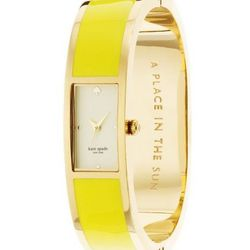 "Carousel Bangle in yellow, <a href=""http://www.katespade.com/carousel-bangle/1YRU0050,default,pd.html?dwvar_1YRU0050_color=700&start=1&cgid=watches"">$250</a>."