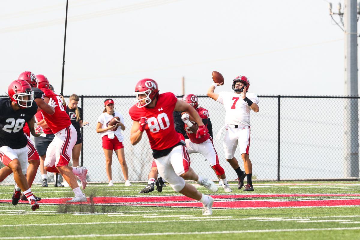 Utah quarterback Cam Rising prepares to throw the ball during fall camp.