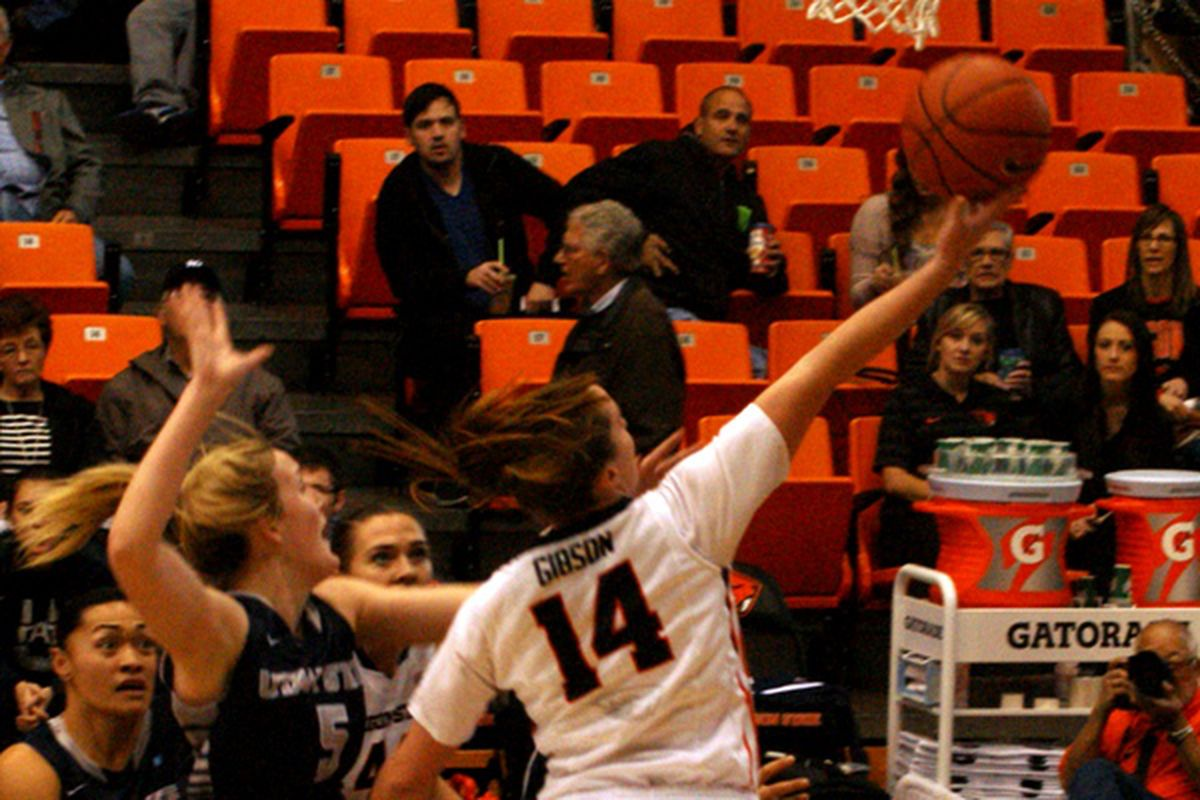 Ali Gibson gets to the basket for 2 of her 12 points against Utah St.