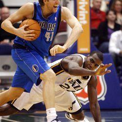 Utah Jazz forward Paul Millsap (24) tries to defend Dallas Mavericks forward Dirk Nowitzki (41) while falling to the floor as the Utah Jazz and the Dallas Mavericks play Monday, April 16, 2012 in Salt Lake City.