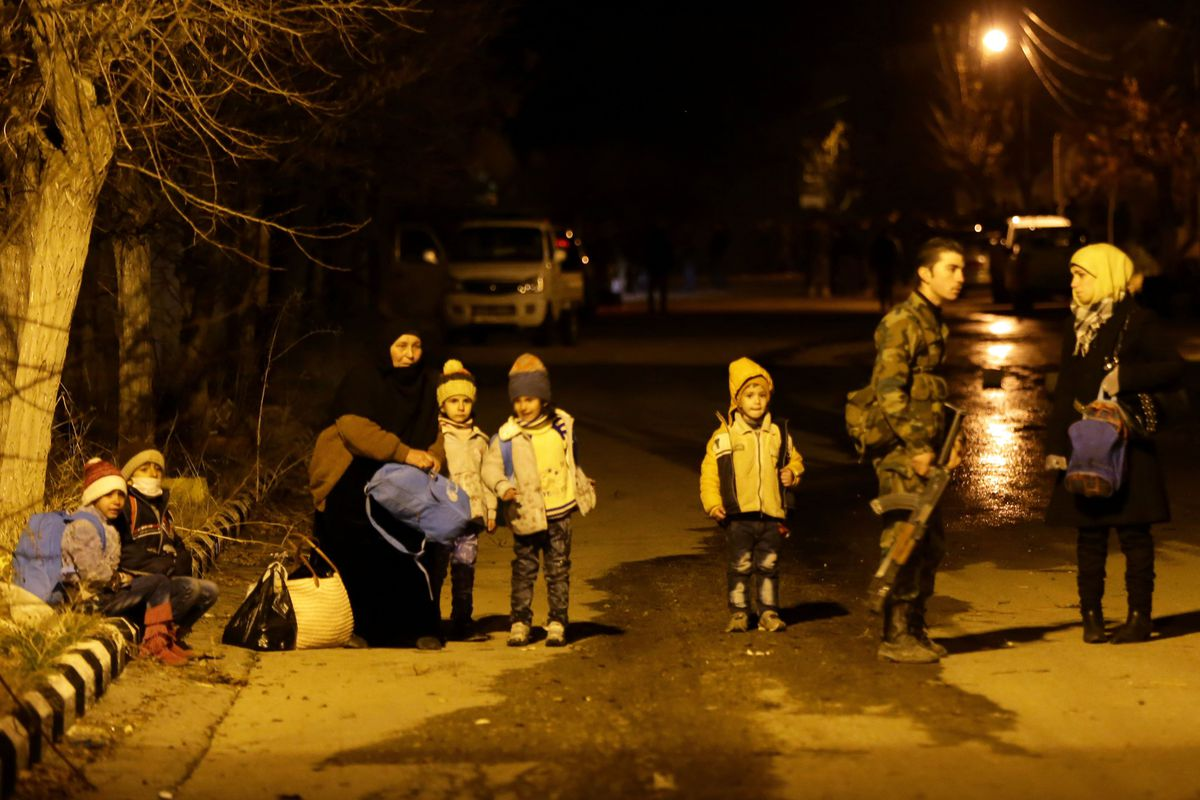 Syrians wait to be evacuated from the Madaya area.