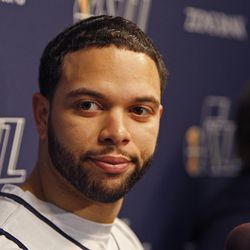 Former Jazz guard Deron Williams answers questions at a media scrum.
