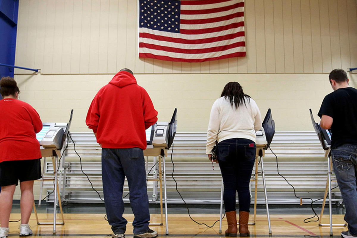 Voters cast their votes during the U.S. presidential election in Elyria, Ohio, on November 8, 2016.