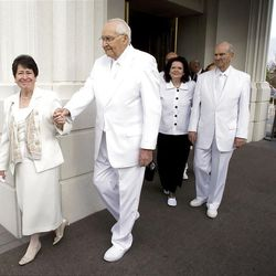 Elder L. Tom Perry of the Quorum of the Twelve Apostles and wife Sister Barbara Perry, left, walk out of the temple with Elder Russell M. Nelson and his wife, Wendy Watson Nelson, right, for the cornerstone ceremony. About 200 took part in the ceremony at the Brigham City Temple prior to the dedication Sunday, Sept. 23, 2012.