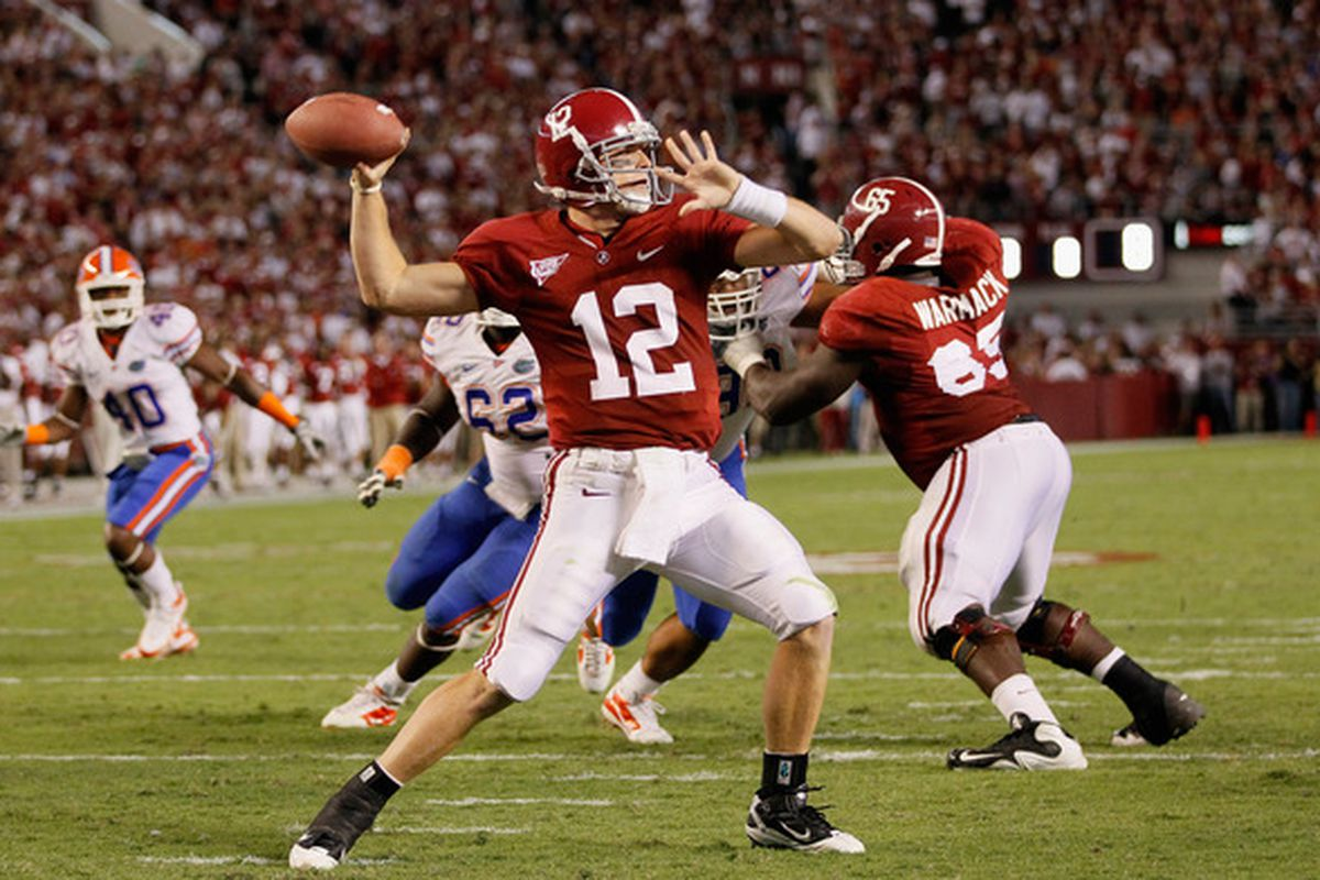 TUSCALOOSA AL - OCTOBER 02:  Quarterback Greg McElroy #12 of the Alabama Crimson Tide looks to pass against the Florida Gators at Bryant-Denny Stadium on October 2 2010 in Tuscaloosa Alabama.  (Photo by Kevin C. Cox/Getty Images)