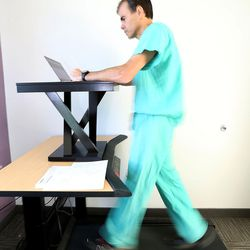 Dr. John Day walks on a treadmill while answering emails in his office at Intermountain Medical Center in Murray on Thursday, Sept. 8, 2016. Day is a cardiologist and Medical Director of Heart Rhythm Services at Intermountain Medical Center.