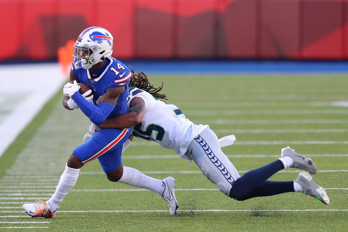 Ryan Neal #35 of the Seattle Seahawks tackles Stefon Diggs #14 of the Buffalo Bills during the second half at Bills Stadium on November 08, 2020 in Orchard Park, New York.