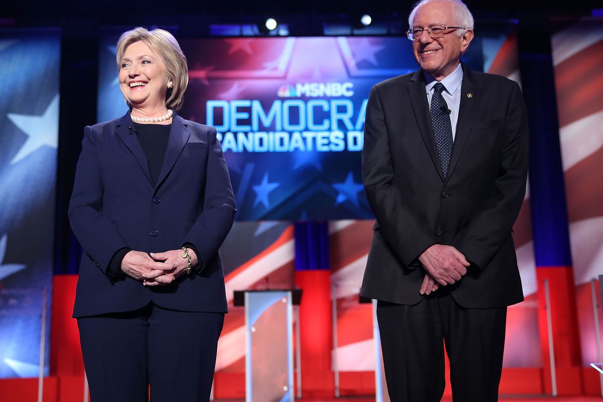 Democratic presidential candidate former Secretary of State Hillary Clinton and US Sen. Bernie Sanders (I-VT) at the start of their MSNBC Democratic debate at the University of New Hampshire.