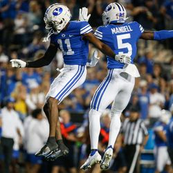 Brigham Young Cougars D'Angelo Mandell (5) and Isaiah Herron celebrate an interception during the first half of an NCAA college football game at LaVell Edwards Stadium in Provo on Saturday, Sept. 11, 2021.