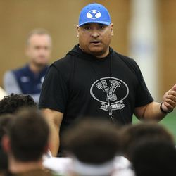 Brigham Young Cougars head coach Kalani Sitake talks with players after an intersquad scrimmage in Provo on Friday, March 23, 2018.