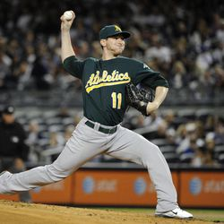Oakland Athletics starting pitcher Jarrod Parker throws to a New York Yankees batter during the first inning of a baseball game Friday, Sept. 21, 2012, at Yankee Stadium in New York.
