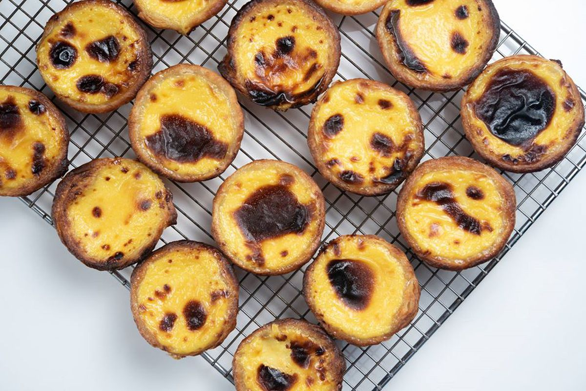Egg tarts cooling on a wire rack