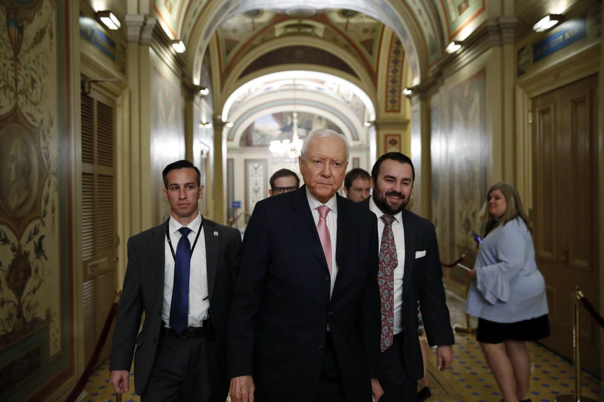 Sen. Orrin Hatch, R-Utah, walks before a vote to advance Brett Kavanaugh's nomination to the Supreme Court, on Capitol Hill, Friday, Oct. 5, 2018 in Washington.