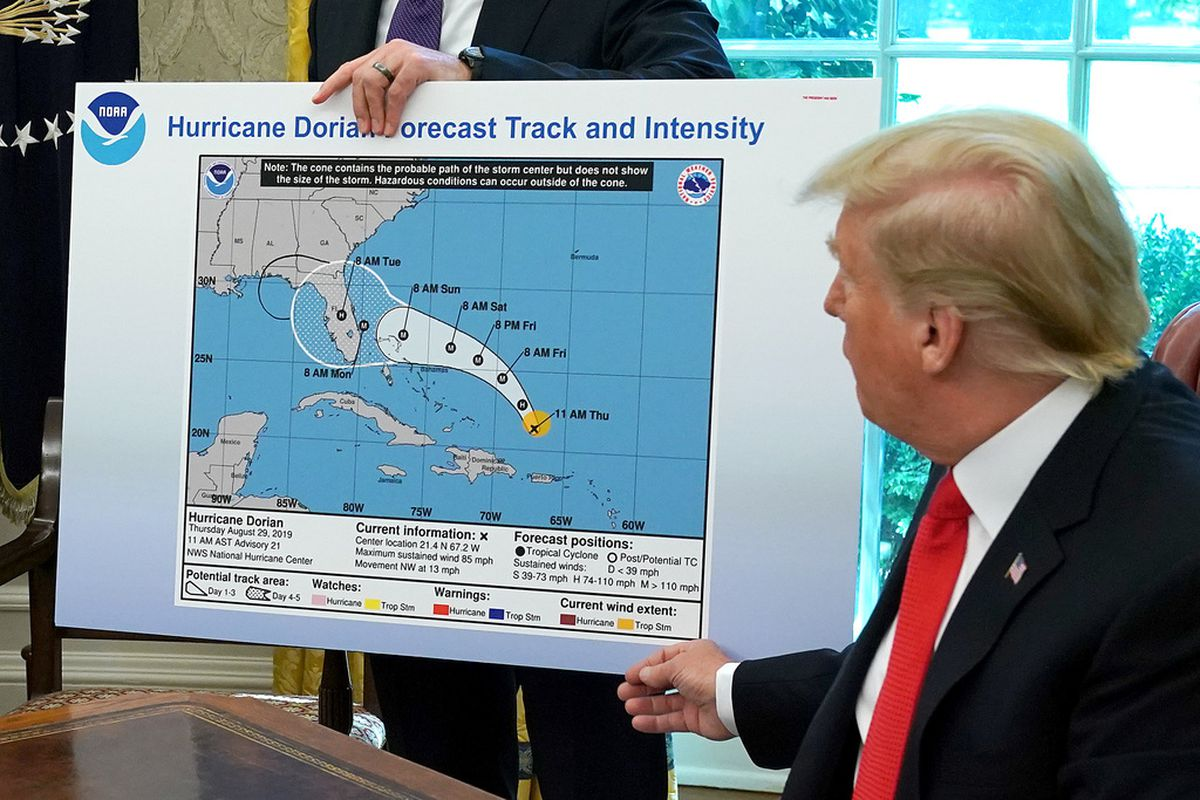 President Donald Trump references a map held by acting Homeland Security Secretary Kevin McAleenan