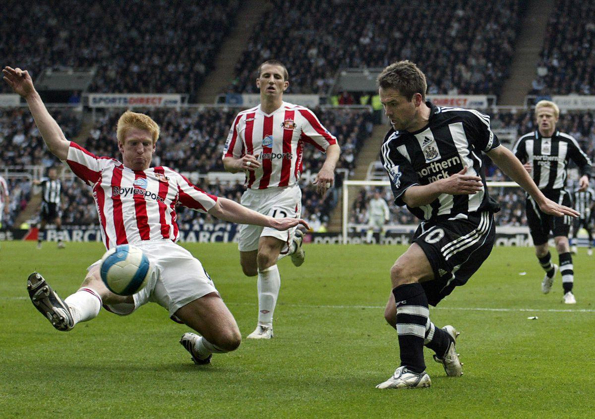 Newcastle's captain Michael Owen (R) man