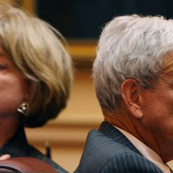 Sen. Janet D. Howell, D-Fairfax, left, and Senate Minority Leader Richard L. Saslaw, D-Fairfax, right, react after the budget bill passed the Senate  at the State Capitol in Richmond, Va., Wednesday, April 18, 2012.
