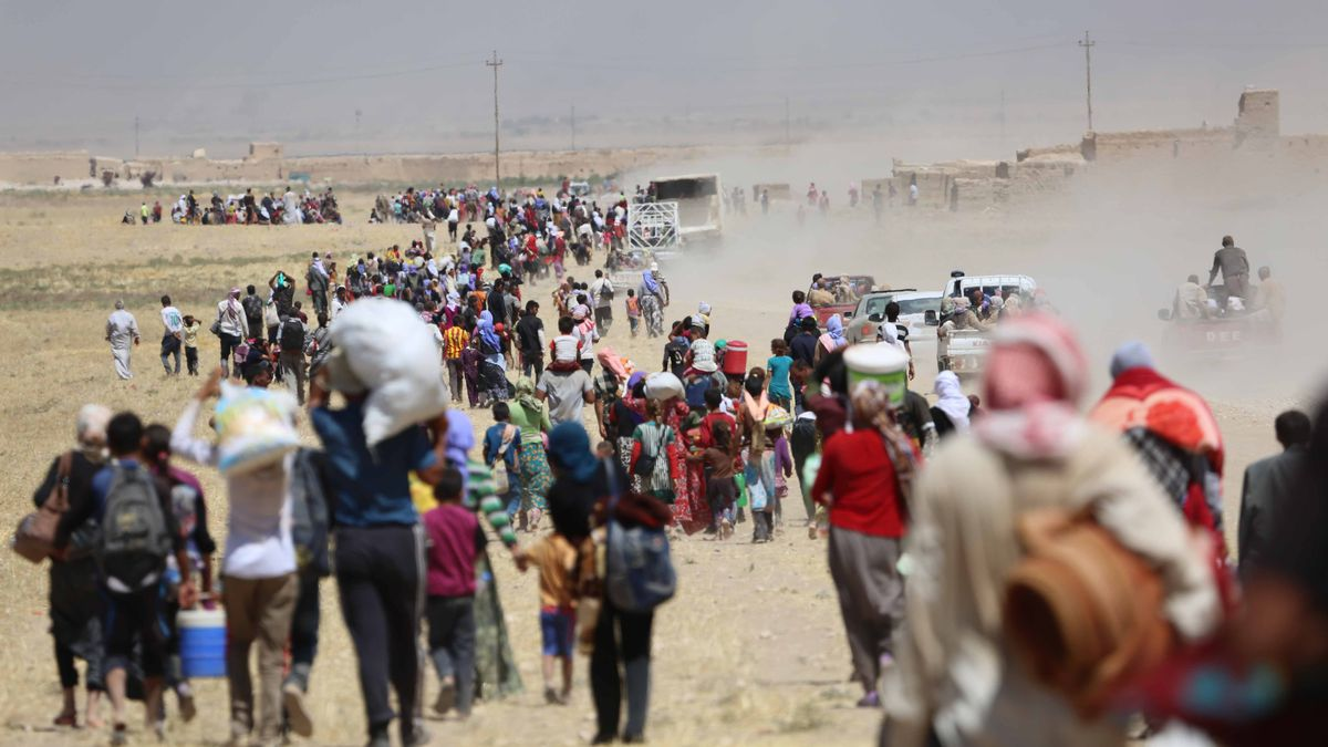 Thousands of Yezidis trapped in the Sinjar mountains in Sinjar, Iraq.