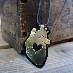 For your tough girlfriend who's a total softie on the inside, a scientifically-accurate heart necklace. Layered Copper/Brass Anatomical Heart, $50, Anatomical Element