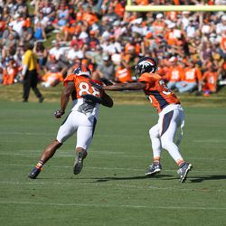 Broncos CB Keyvon Webster tries to slow down WR Demaryius Thomas during training camp.