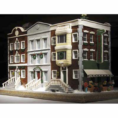 Gingerbread scene of a restaurant on a snowy New York City street corner.