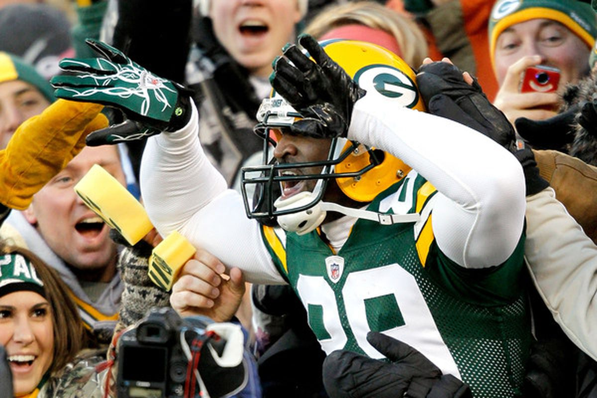 James Jones (89) of the Green Bay Packers leaps into the stands after scoring a touchdown against the New York Giants at Lambeau Field on December 26 2010 in Green Bay Wisconsin.  (Photo by Matthew Stockman/Getty Images)