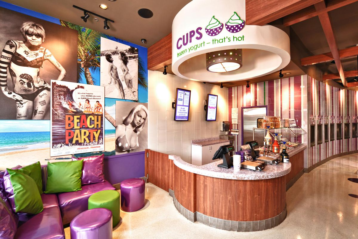 Get ready for tunes and scantily clad women serving fro-yo at Cups Frozen Yogurt.