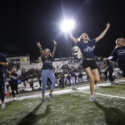Students storm the field after Corner Canyon scored the game-winning touchdown with two seconds left in the game, giving them a victory over Lone Peak at Corner Canyon High School in Draper on Friday, Sept. 27, 2019.