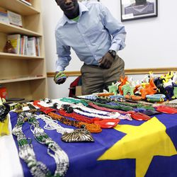 Dominic Raimondo sells clay sculptures and jewelry from his native South Sudan during a volunteer open house event at the Utah Refugee Education and Training Center in Salt Lake City, Saturday, Jan. 9, 2016. Raimondo uses the profits for a foundation in his home country building schools.