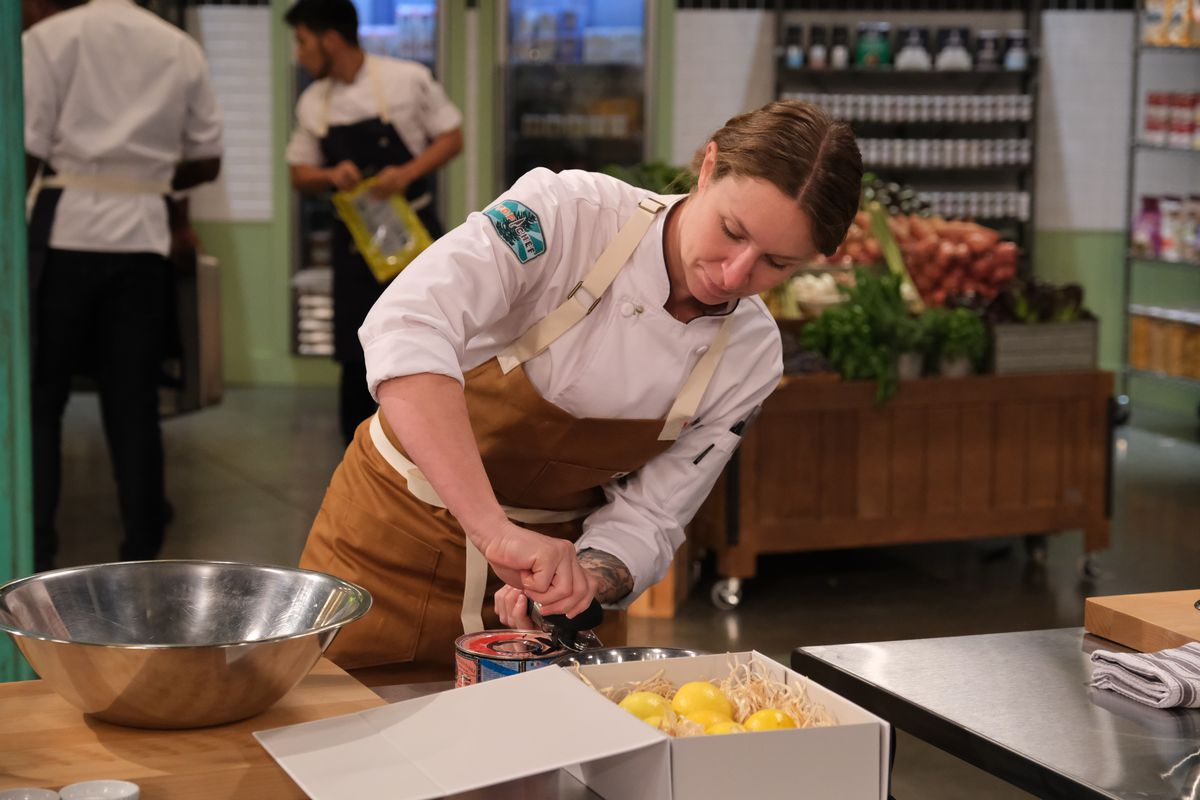 Sara Hauman leans over a lemon juicer during a challenge during the first episode of Top Chef season 18