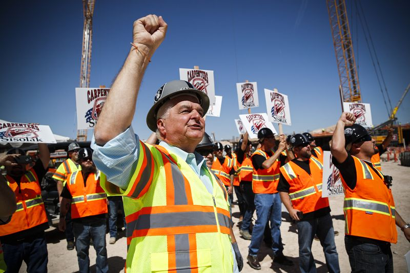 Democratic gubernatorial candidate Steve Sisolak chants with supporters while touring the site of the future Raiders football stadium on June 11, 2018, in Las Vegas.