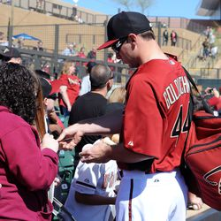 Paul Goldschmidt signs autographs prior to the game