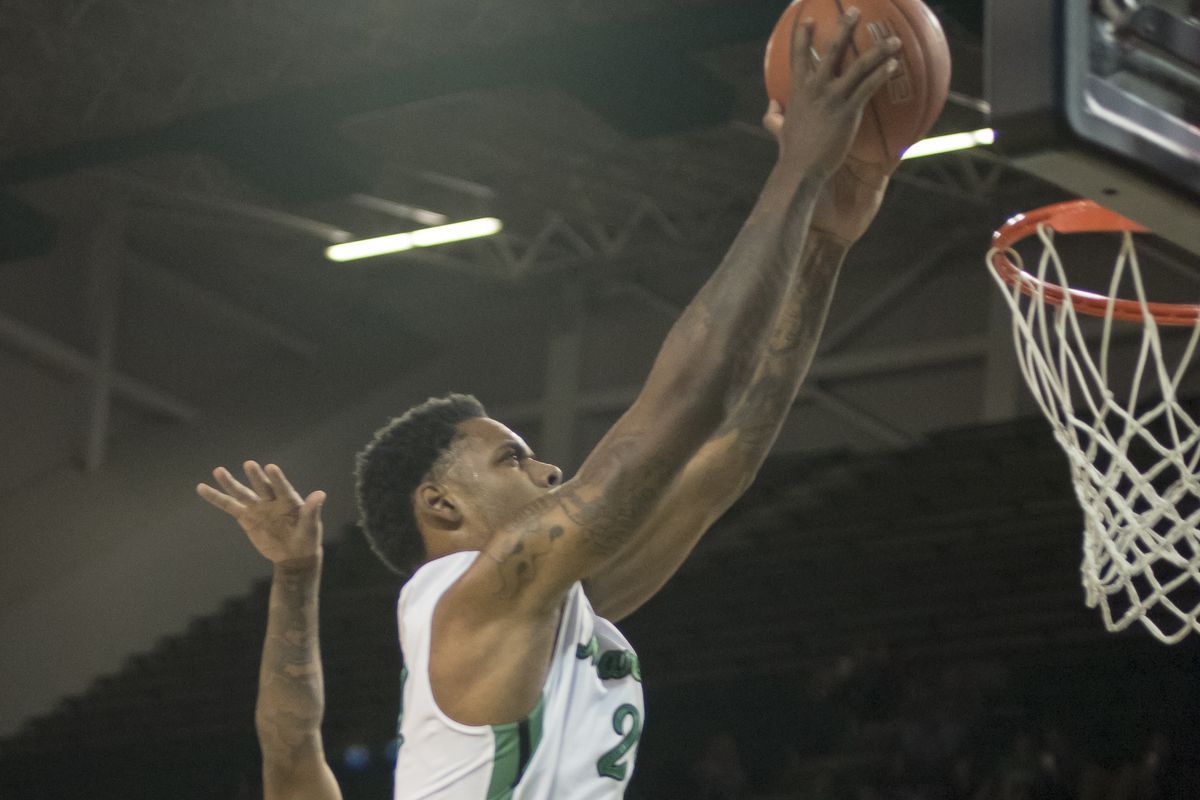 Marshall's James Kelly (24) slams home another dunk over FIU.
